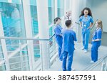 group of students in blue... | Shutterstock . vector #387457591