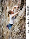 Female climber on a steep crag. - stock photo