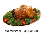 A spicy whole roast chicken on a platter - stock photo