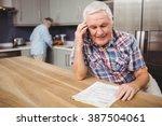 senior man talking on phone and ... | Shutterstock . vector #387504061
