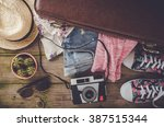 travel preparations on wooden... | Shutterstock . vector #387515344
