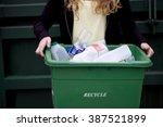 a teenage girl holding a... | Shutterstock . vector #387521899