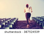 runner athlete running on... | Shutterstock . vector #387524539
