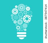 light bulb of gears and cogs.... | Shutterstock . vector #387547414