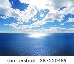 open sea with sun  sparkling... | Shutterstock . vector #387550489