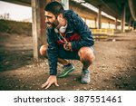 exhausted man resting after... | Shutterstock . vector #387551461