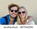 hip couple with sunglasses... | Shutterstock . vector #387566581