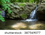 Small Waterfall In Forest With...