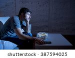 young television addict man... | Shutterstock . vector #387594025