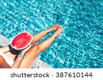 girl holding watermelon in the... | Shutterstock . vector #387610144