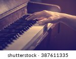 hands on the key of the piano... | Shutterstock . vector #387611335