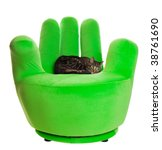 Green finger chair with a house cat relaxing on it - stock photo