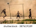 boy kicking a soccer ball  | Shutterstock . vector #387619189