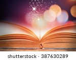 abstract colorful magic book on ... | Shutterstock . vector #387630289