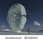 lonely man standing before big mystical head - stock photo