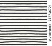 hand drawn striped pattern.... | Shutterstock .eps vector #387716704