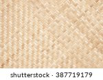 close up woven bamboo pattern | Shutterstock . vector #387719179