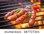 german sausages on the barbecue ... | Shutterstock . vector #387727201