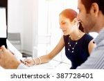 business people in modern office | Shutterstock . vector #387728401