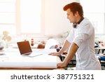 young man standing in creative... | Shutterstock . vector #387751321