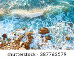 Waves On A Rocky Beach At...