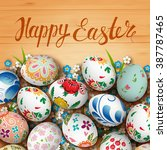 easter eggs and flowers on the... | Shutterstock . vector #387787465