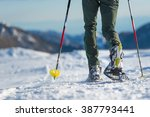 snowshoes. walking with... | Shutterstock . vector #387793441