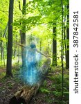 Small photo of Young woman balancing in nature - Energetic aura effect