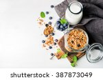 healthy breakfast ingredients.... | Shutterstock . vector #387873049