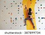 Athletic Woman Climbing Indoor...