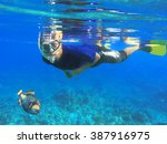asian snorkel and big fish... | Shutterstock . vector #387916975