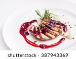 duck breast with sauce | Shutterstock . vector #387943369