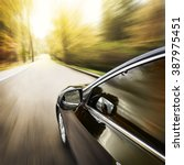 blurred road and car  speed... | Shutterstock . vector #387975451