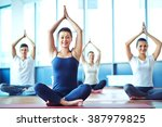 young woman practicing yoga in... | Shutterstock . vector #387979825