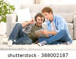 two teenager boys listening to... | Shutterstock . vector #388002187