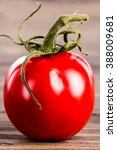 red tomatoes on rustic wooden... | Shutterstock . vector #388009681