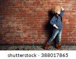 portrait of little fashion kid... | Shutterstock . vector #388017865