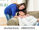 young couple smiling and having ... | Shutterstock . vector #388032541