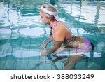 Fit Woman Doing Underwater Bik...