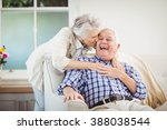 senior woman embracing man in... | Shutterstock . vector #388038544