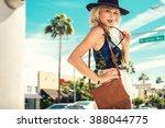 nice young woman walking in the ... | Shutterstock . vector #388044775