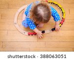 little girl playing with trains ... | Shutterstock . vector #388063051