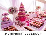 delicious sweets on candy buffet | Shutterstock . vector #388120939