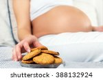 close up of a pregnant woman... | Shutterstock . vector #388132924