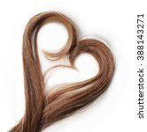 strands of brown hair in shape... | Shutterstock . vector #388143271