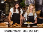 pretty waitresses behind the... | Shutterstock . vector #388151134