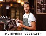 handsome waiter adding milk to... | Shutterstock . vector #388151659