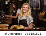 pretty waitress holding a tray... | Shutterstock . vector #388151821