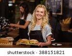 pretty waitress holding a tray... | Shutterstock . vector #388151821