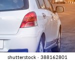 Stock photo white back car on the street driving on road 388162801